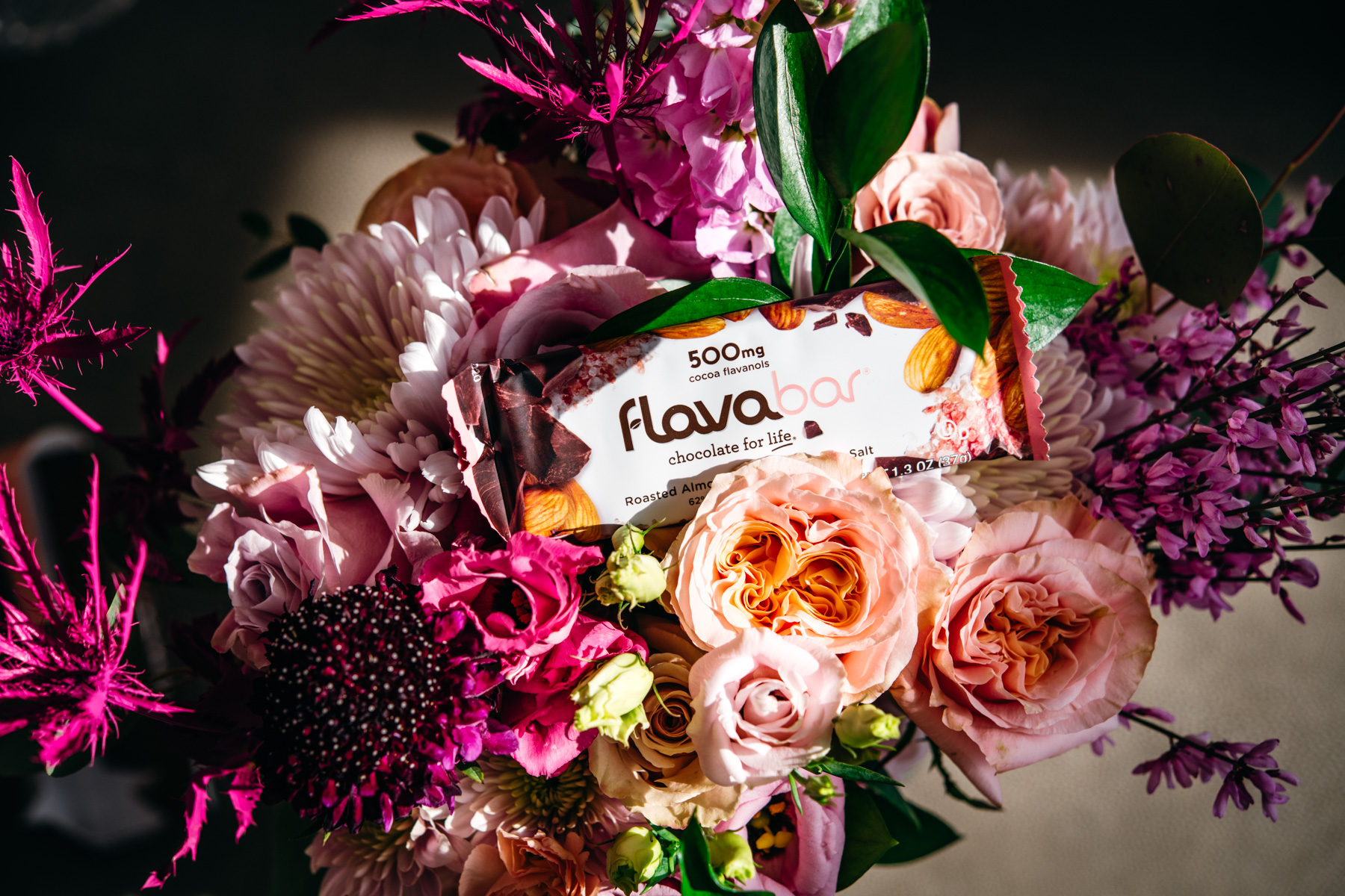 Chocolate almond FlavaBar in a bouquet of pink flowers.